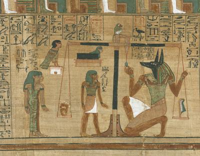 Detalle del 'Libro de los Muertos', que muestra a Anubis colocando un corazón en la balanza.